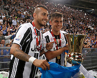 Calcio, finale Tim Cup: Milan vs Juventus. Roma, stadio Olimpico, 21 maggio 2016.<br /> Juventus&rsquo; Roberto Pereyra, left, and Paulo Dybala hold the trophy at the end of the Italian Cup final football match between AC Milan and Juventus at Rome's Olympic stadium, 21 May 2016. Juventus won 1-0 in the extra time.<br /> UPDATE IMAGES PRESS/Isabella Bonotto