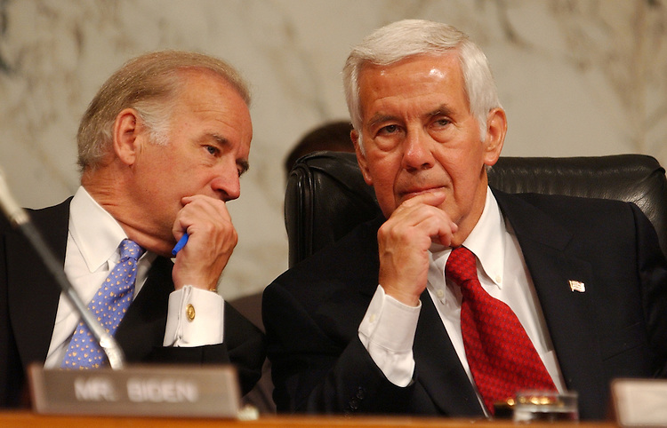 "lugar2/042903 -- Sens. Richard Lugar, R-Ind., right, and Joe Biden, D-Del., confer during an Senate Foreign Relations Committee on ""An Enlarged NATO: Mending Fences and Moving Forward on Iraq"", in which Secretary of State Colin Powell, testified."