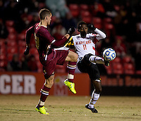 Mikias Eticha (11) of Maryland fights for the ball with Cole DeNormandie (23) of Boston College during the ACC tournament quarterfinals at Ludwig Field in College Park, MD.  Maryland defeated Boston College, 2-0.