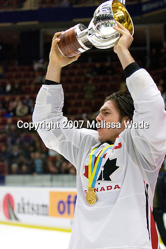 Kristopher Letang (Ste-Julie, QC - Foreurs de Val d'Or) - Team Canada celebrates with the gold medal trophy following Team Canada's 4-2 victory over Team Russia in the 2007 World Championship on Friday, January 5, 2007 at Ejendals Arena in Leksand, Sweden.