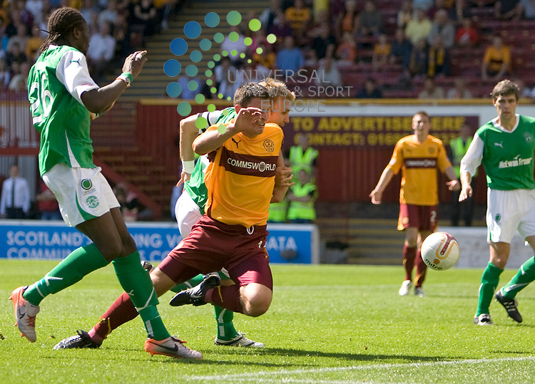 John Sutton(11) is puled back by Hib's Chris Hogg (captain) but no penalty was rewarded during The Clydesdale Bank Premier League match between Motherwell and Hibernian at Fir Park 15/08/10..Picture by Ricky Rae/universal News & Sport (Scotland).