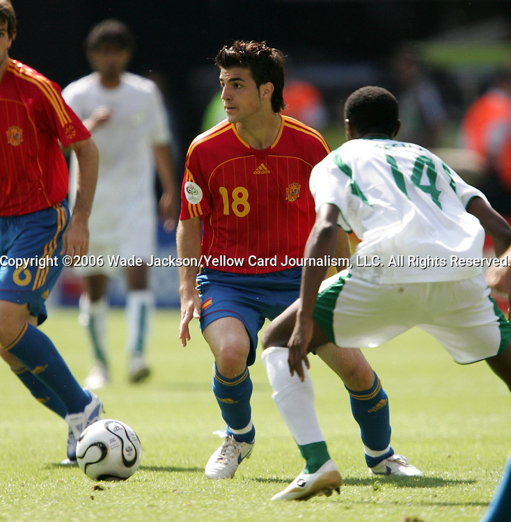 23 June 2006: Cesc Fabregas (ESP) (18) is defended by Saud Khariri (KSA) (14). Saudi Arabia lost to Spain at Fritz-Walter Stadion in Kaiserslautern, Germany in match 47, a Group H first round game, of the 2006 FIFA World Cup.
