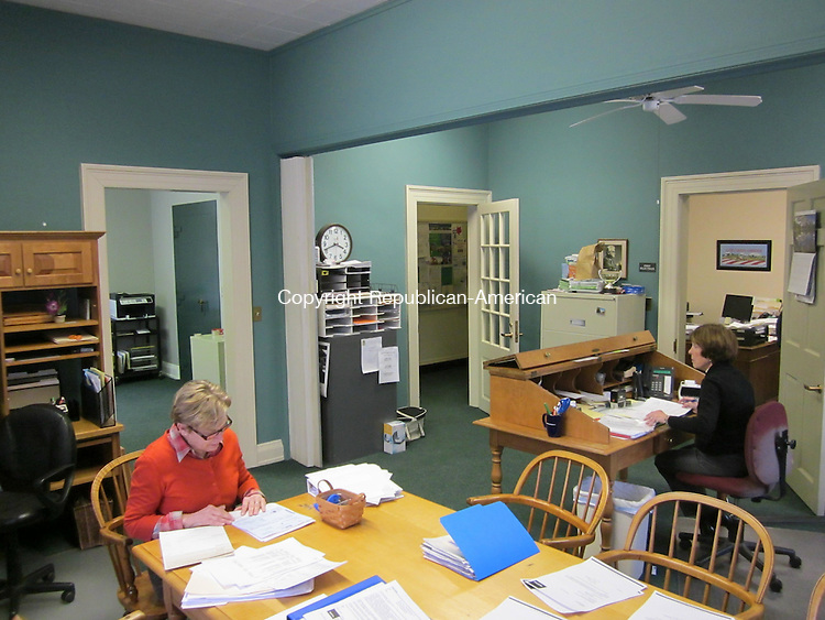 WASHINGTON, CT - 2 March 2012 - 030212RH02 - Kathleen Gallow, left, and Phyllis Allen, right, work in a roomier selectmen's office in Washington, Conn. Workers removed a door to make more space for Gallow and the town's treasurer in a room that had been used by the probate office. Rick Harrison Republican-American