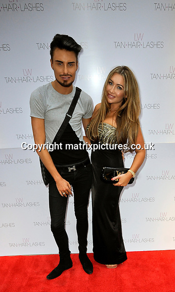 """NON EXCLUSIVE  PICTURE: MATRIXPICTURES.CO.UK.PLEASE CREDIT ALL USES..WORLD RIGHTS..English former TOWIE reality TV star Lauren Goodger is pictured launching her new """"Lauren's Way"""" range of fake tan, eyelashes and hair products in London...She is joined by TV personality star Rylan Clark...MAY 8th 2013..REF: PSE 133063"""