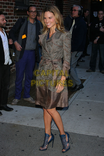 HILARY SWANK.Hilary Swank at the Ed Sullivan Theater for an appearance on the 'Late Show with David Letterman', New York, NY, USA..October 13th, 2010.full length beige grey gray print coat jacket blue strappy sandals.CAP/LNC/TOM.©LNC/Capital Pictures.