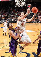 Jan. 2, 2011; Charlottesville, VA, USA; Virginia Cavaliers forward Will Regan (4) drives to the basket next to LSU Tigers forward Garrett Green (3) during the game at the John Paul Jones Arena. Virginia won 64-50. Mandatory Credit: Andrew Shurtleff-