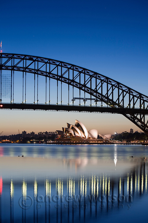 View of the Sydney Opera House and Harbour Bridge from Blues Point at dawn.  Sydney, New South Wales, AUSTRALIA