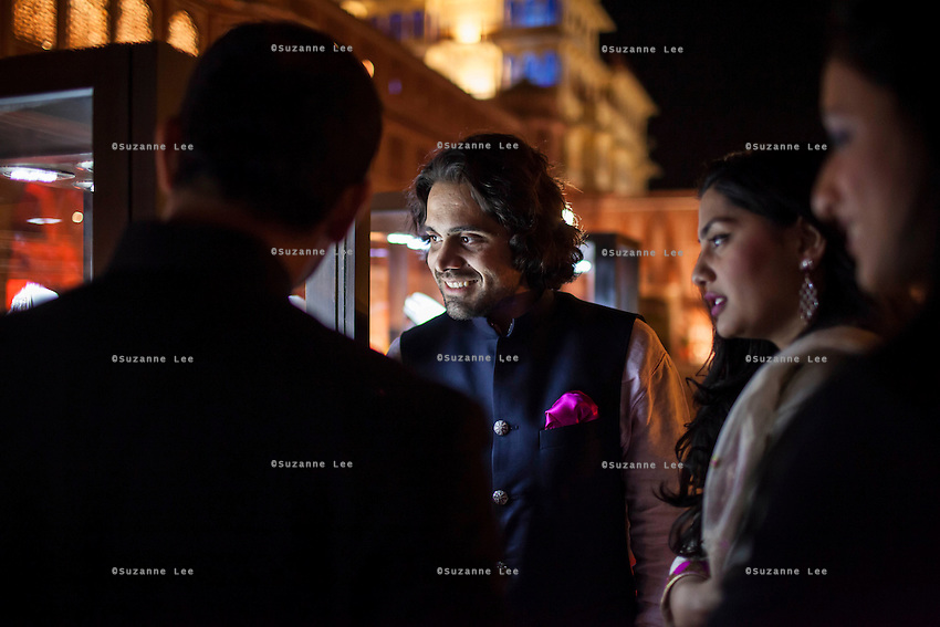 Gem Palace director Siddharth Kasliwal (center) and other guests admire Argyle pink diamond jewellery by Nirav Modi at the OzFest Gala Dinner in the Jaipur City Palace, in Rajasthan, India on 10 January 2013. Photo by Suzanne Lee