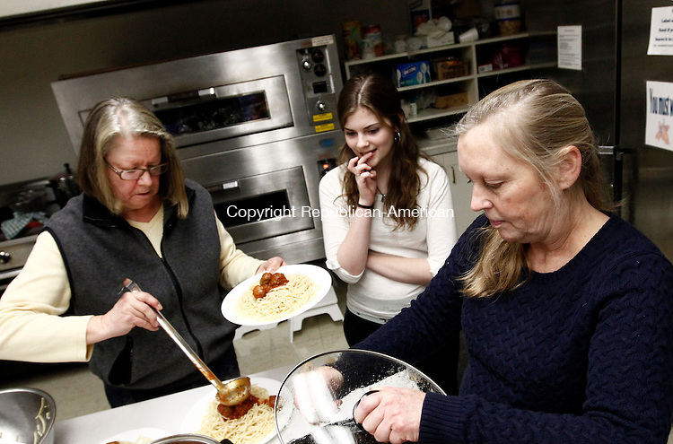 Southbury, CT- 25 January 2015-012515CM12-  Anik Claflin, left, and Kate Noble, right, prepare a dish of pasta for Kristen Bacigalupi, 17,  of Southbury, to be served  during a pasta dinner put on by members of the Senior High Pilgrim Fellowship at the United Church of Christ in Southbury on Sunday. Proceeds from the dinner will benefit the group's 2015 Summer Mission Trip.    Christopher Massa Republican-American