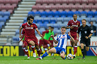Ryan Colclough of Wigan Athletic slides in on Mohamed Salah of Liverpool during the pre season friendly match between Wigan Athletic and Liverpool at the DW Stadium, Wigan, England on 14 July 2017. Photo by Andy Rowland.