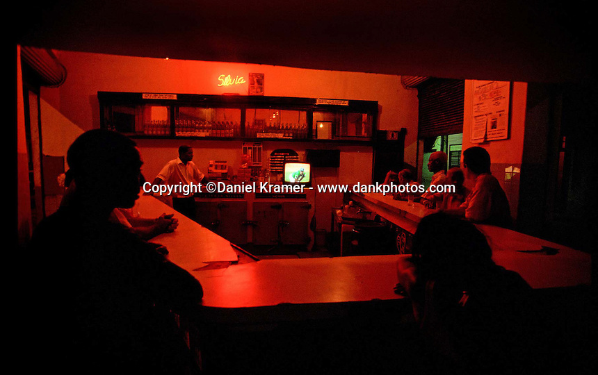 At a neighborhood bar in Havana people watch the Cuban National Series between Santiago de Cuba and Pinar del Rio. (2000).