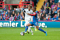 Sun 22 September 2013<br /> <br /> Pictured: Jose Canas  of Swansea prepares to tackle Jason Puncheon of Crystal Palace<br /> <br /> Re: Barclays Premier League Crystal Palace FC  v Swansea City FC  at Selhurst Park, London