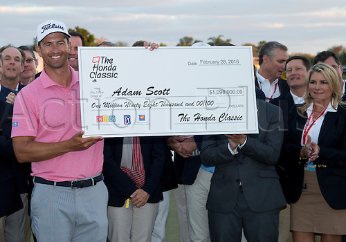 28.02.2016. Palm Beach, Florida, USA.  Adam Scott smiles as he holds the check after winning the final round of the Honda Classic at the PGA National Resort & Spa in Palm Beach Gardens, FL.