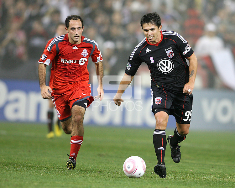 Jaime Moreno #99 of D.C. United moves away from Nick LaBrocca #21 of Toronto FC during an MLS match that was the final appearance of D.C. United's Jaime Moreno at RFK Stadium, in Washington D.C. on October 23, 2010. Toronto won 3-2.