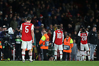 Arsenal players walk towards the dressing room after losing 2-1 during Arsenal vs Eintracht Frankfurt, UEFA Europa League Football at the Emirates Stadium on 28th November 2019