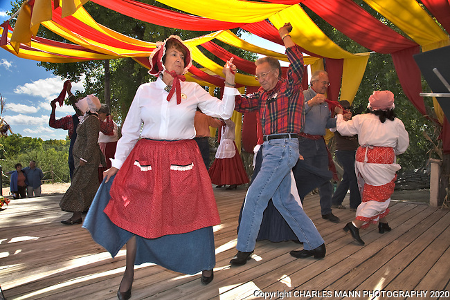 A colorfully dressed troupe of volunteers demonstrates traditional folk dances at the Fall Festival at the historical museum of Rancho de Las Golondrinas near Santa Fe, New Mexico