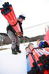 FRANCONIA, NH - MARCH 10:   UNH assistant ski coach Kate Anderson readies slalom gates the prior to the Slalom event at the Division I Men's and Women's Skiing Championships held at Cannon Mountain on March 10, 2017 in Franconia, New Hampshire. (Photo by Gil Talbot/NCAA Photos via Getty Images)