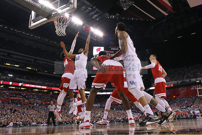 Center Karl-Anthony Towns of the Kentucky Wildcats shoots a hook shot during the game against the Wisconsin Badgers in the Final Four of the 2015 NCAA Men's Basketball Tournament at Lucas Oil Stadium on Saturday, April 4, 2015 in Indianapolis, In.  Photo by Michael Reaves | Staff.