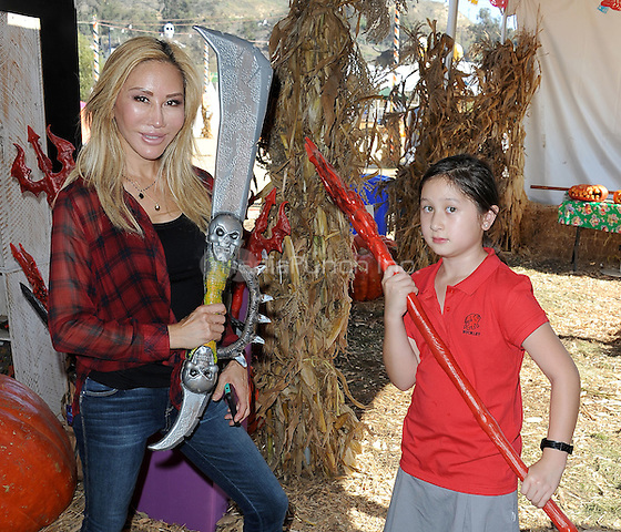 CULVER CITY,  CA - OCTOBER 29:  Tess Broussard and daughter Ava visit Mr. Bones Pumpkin Patch on October 29, 2015 in Culver City, California. Credit: PGSKMediaPunch