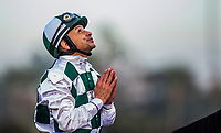 ARCADIA, CA - DECEMBER 30: Mike Smith looks to the heavens after winning the American Okas at Santa Anita Park on December 30, 2017 in Arcadia, California. (Photo by Alex Evers/Eclipse Sportswire/Getty Images)