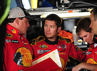Sept. 20, 2008; Dover, DE, USA; Nascar Sprint Cup Series driver Martin Truex Jr (center) talks with his crew during practice for the Camping World RV 400 at Dover International Speedway. Mandatory Credit: Mark J. Rebilas-