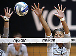 Nevada Senior middle hitter Tessa Lea'ea goes up for a block in a college volleyball match against Air Force in Reno, Nev., on Thursday, Sept. 25, 2014. Air Force won 3-2. <br /> Photo by Cathleen Allison