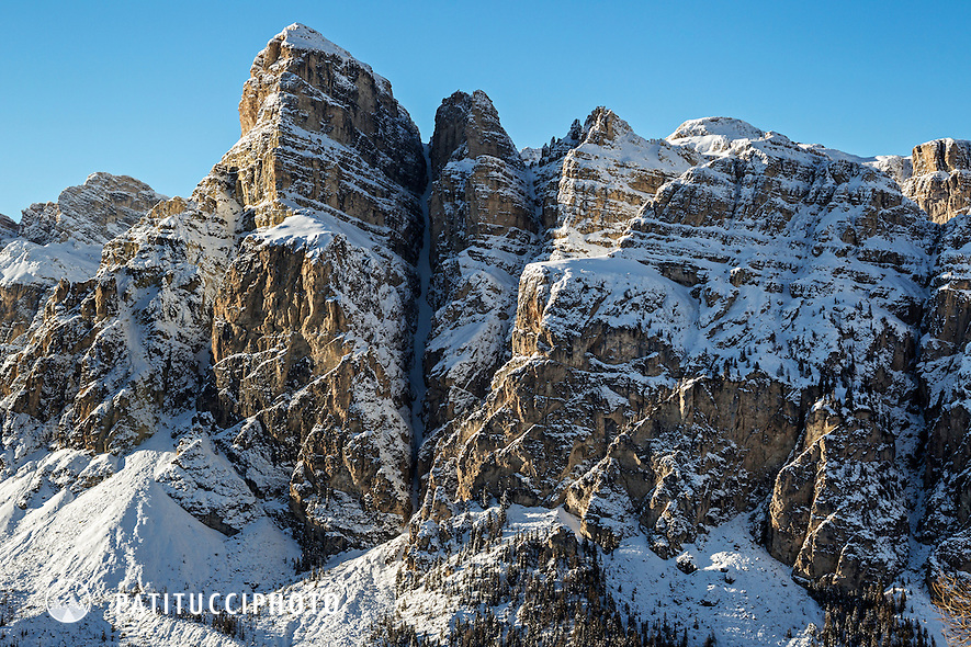 The Dolomites Sassongher and famous ski descent Val Scura, the steep and narrow couloir, high above the Alta Badia