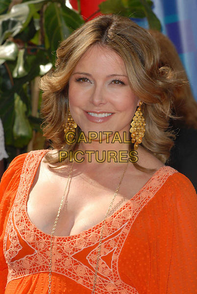 CHRISTA MILLER.58th Annual Primetime Emmy Awards held at the Shrine Auditorium, Los Angeles, California, USA..August 27th, 2006.Ref: ADM/CH.headshot portrait orange gold earrings.www.capitalpictures.com.sales@capitalpictures.com.©Charles Harris/AdMedia/Capital Pictures.