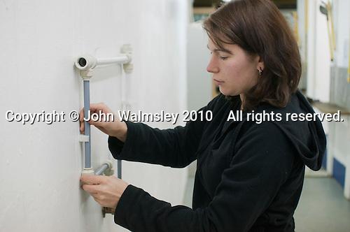 Plumbing student preparing some plumbing to an exact specification, Able Skills, Dartford, Kent.