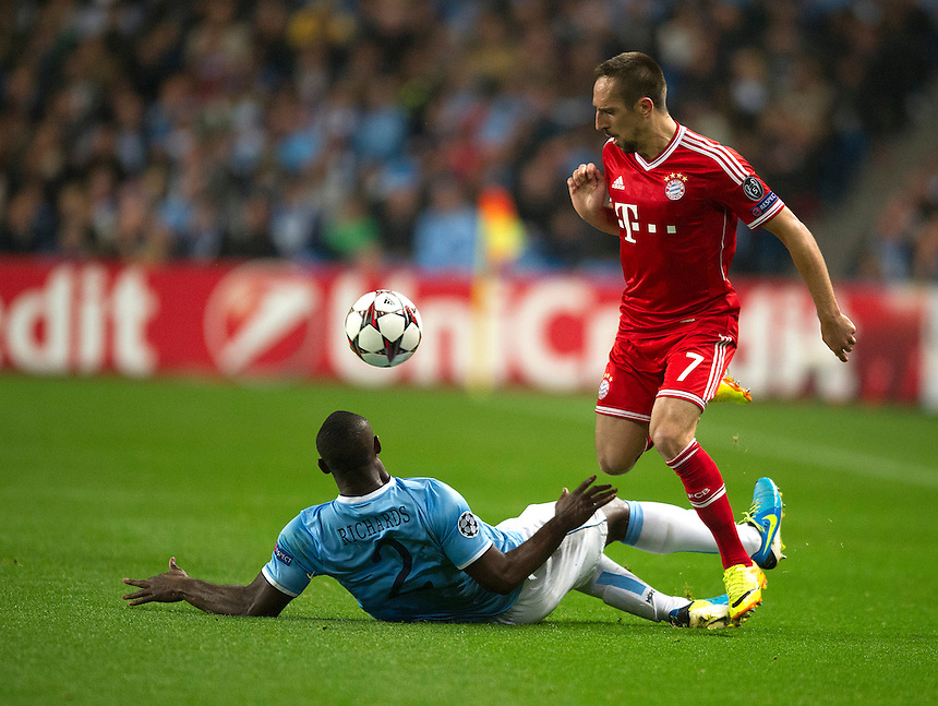 Bayern Munich's Franck Ribery skips over the challenge from Manchester City's Micah Richards<br /> <br /> Photo by Stephen White/CameraSport<br /> <br /> Football - UEFA Champions League Group D - Manchester City v Bayern Munich - Wednesday 2nd October 2013 -  Etihad Stadium - Manchester<br /> <br /> &copy; CameraSport - 43 Linden Ave. Countesthorpe. Leicester. England. LE8 5PG - Tel: +44 (0) 116 277 4147 - admin@camerasport.com - www.camerasport.com