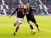 17th March 2018, Tynecastle Park, Edinburgh, Scotland; Scottish Premier League football, Heart of Midlothian versus Partick Thistle;  Marcus Godinho of Hearts and Miles Storey of Partick Thistle challenge for the ball