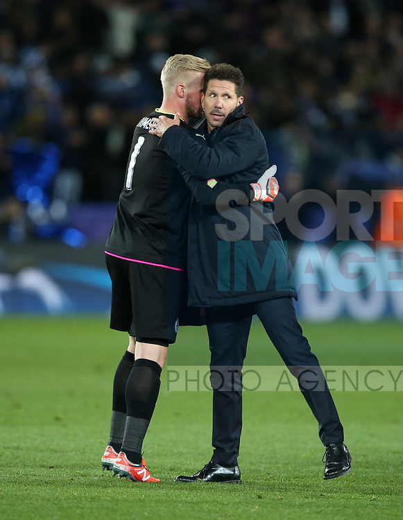 Leicester's Kasper Schmeichel is consoled by Atletico's Diego Simeone during the Champions League Quarter-Final 2nd leg match at the King Power Stadium, Leicester. Picture date: April 18th, 2017. Pic credit should read: David Klein/Sportimage