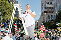 An organizer addresses participants before the Straight Pride Parade in Boston, Massachusetts, on Sat., August 31, 2019.