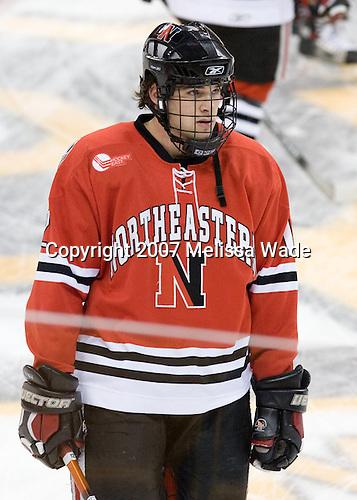 Dennis McCauley (NU - 12) - The Northeastern University Huskies defeated the Harvard University Crimson 3-1 in the Beanpot consolation game on Monday, February 12, 2007, at TD Banknorth Garden in Boston, Massachusetts.