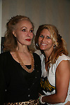 Julie Newmar and Lesley (daughter of Lee Meriwether) & stuntdouble for Julie Newmar at the Super Megashow & Comic Fest on August 30, 2009 in Secaucus, New Jersey (Photo by Sue Coflin/Max Photos)