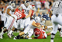 Jan. 1, 2011; Glendale, AZ, USA; Connecticut Huskies quarterback (10) Zach Frazer is sacked by the Oklahoma Sooners defense in the first half in the 2011 Fiesta Bowl at University of Phoenix Stadium. Mandatory Credit: Mark J. Rebilas-