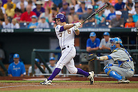 LSU Tigers shortstop Alex Bregman #30 bats in front of UCLA Bruins catcher Shane Zeile #14 during Game 4 of the 2013 Men's College World Series between the LSU Tigers and UCLA Bruins at TD Ameritrade Park on June 16, 2013 in Omaha, Nebraska. The Bruins defeated the Tigers 2-1. (Brace Hemmelgarn/Four Seam Images)