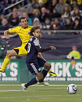 Columbus Crew midfielder Dilly Duka (11) gets shot past New England Revolution defender Kevin Alston (30) and scores. In a Major League Soccer (MLS) match, the Columbus Crew defeated the New England Revolution, 3-0, at Gillette Stadium on October 15, 2011.