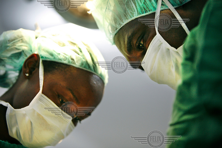 Surgeon at the operating theatre in the disability hospital of CCBRT (Comprehensive Community Based Rehabilitation in Tanzania) in Dar es Salaam. CCBRT hospital provides a wide range of affordable curative services to people with visual and physical impairments.