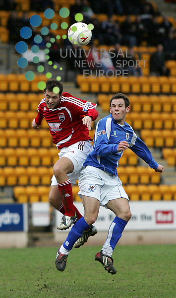 St. Johnstone v Ross County, McDiarmid park, Perth - 07/03/2009.Irn-Bru Scottish Football League First Division, Season 2008/09..Ross County's Paul Lawson and St. Johnstone's Kevin Moon go in for the high ball.  Half time 0 -0.  Picture by John Cockburn/ Universal News & Sport (Scotland)