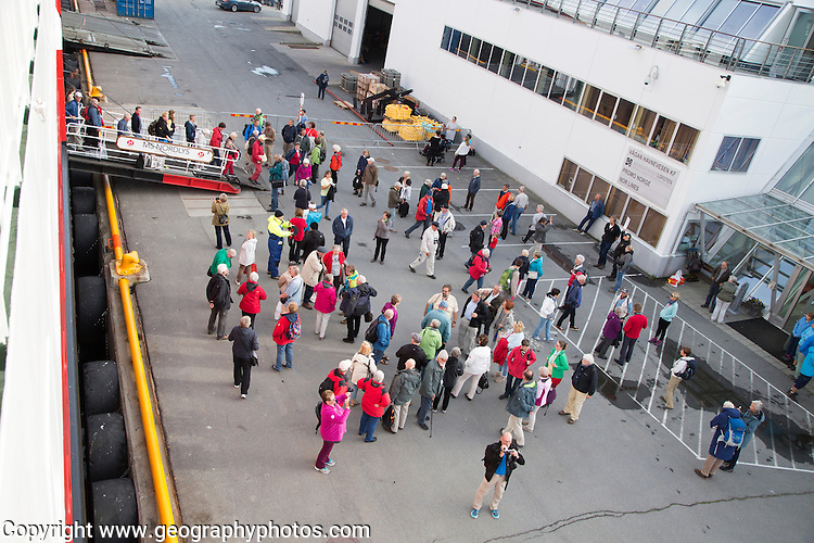 Passengers disembarking on quayside, Nordlys Hurtigruten ferry ship, Svolvaer, Lofoten Islands, Nordland, Norway