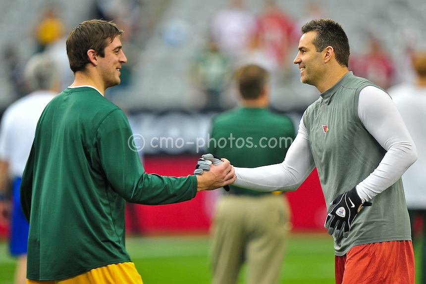 Jan 10, 2010; Glendale, AZ, USA; Green Bay Packers quarterback Aaron Rodgers (left) and Arizona Cardinals quarterback Kurt Warner (right) shake hands prior to the 2010 NFC wild card playoff game at University of Phoenix Stadium.  Mandatory Credit: Chris Morrison-US PRESSWIRE