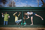 From left, and unidenitfied girl, seven-year-old Leah Bursch, eight-year-old Kessley O'Keefe, and nine-year-old Paige Nye cheer for their favorite players during Opening Day of River Park Youth Baseball in Sacramento, Calif., March 12, 2011.