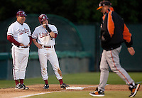 STANFORD, CA - April 12, 2011: Zach Jones of Stanford baseball jokes with third base coach Dean Stotz during a Pacific mound conference during Stanford's game against Pacific at Sunken Diamond. Stanford won 3-1.