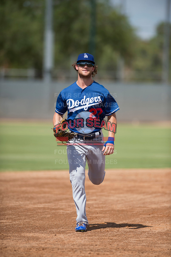 Los Angeles Dodgers right fielder Andrew Shaps (27) jogs off the field between innings of an Instructional League game against the Milwaukee Brewers at Maryvale Baseball Park on September 24, 2018 in Phoenix, Arizona. (Zachary Lucy/Four Seam Images)