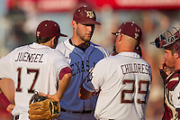 Texas A&M Aggie starting pitcher Michael Wacha #38 talks with manager Rob Childress #29 during the NCAA Tournament Regional baseball game against the Dayton Flyers on June 1, 2012 at Blue Bell Park in College Station, Texas. The Aggies defeated the Flyers 4-1. (Andrew Woolley/Four Seam Images)