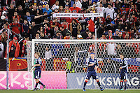 """New York Red Bulls fans hold up a sign reading """"Solidarity with the Philliy Four"""". The New York Red Bulls defeated the New England Revolution 2-0 during a Major League Soccer (MLS) match at Red Bull Arena in Harrison, NJ, on October 21, 2010."""