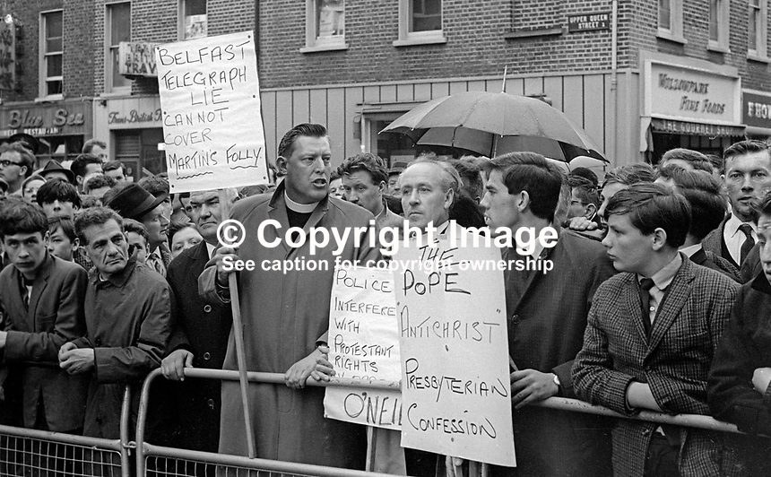 Rev Ian Paisley, Moderator, Free Presbyterian Church, along with supporters protests outside the annual General Assembly of the mainstream Presbyterian Church in Ireland. June 1967. Ref: 196706001.<br />