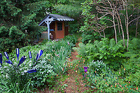 Earthen path leading to potting shed using repurposed materials in Taylor SITES garden