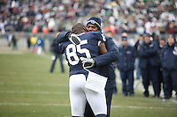 State College, PA - 11/27/2010:  Senior DT Ollie Ogbu is congratulated by coach Larry Johnson during the senior recognition before the game.  Penn State lost to Michigan State by a score of 28-22 on Senior Day at Beaver Stadium...Photo:  Joe Rokita / JoeRokita.com..Photo ©2010 Joe Rokita Photography